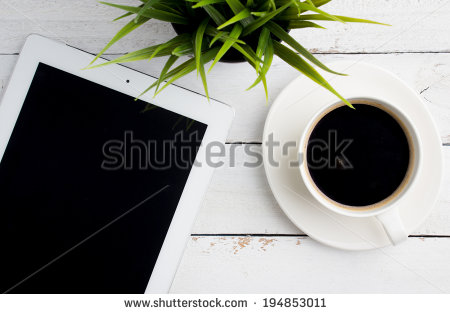 stock-photo-top-view-of-office-desk-a-cup-of-coffee-and-tablet-computer-194853011